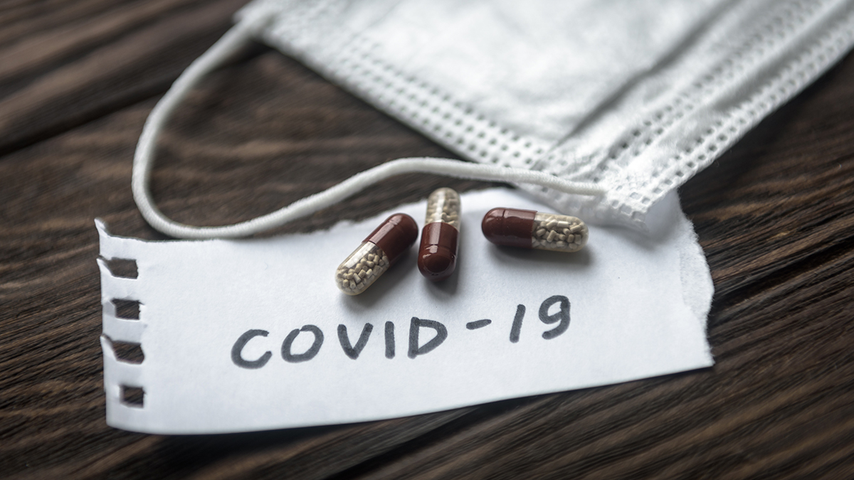 COVID-19 coronavirus concept. Protective mask and pill capsules